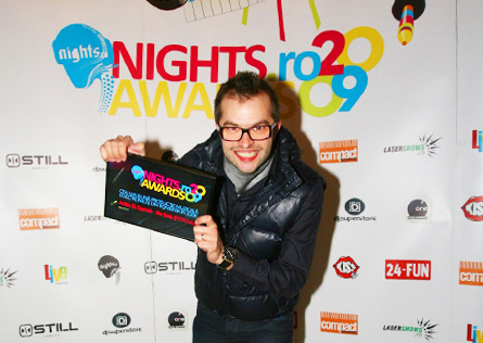 nights awards 2009: dj optick showing his award diploma in front of the logo wall (spider)